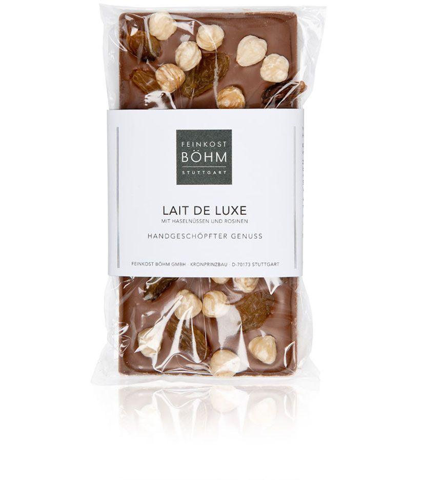 Feinkost Böhm Lait de Luxe Vollmilchschokolade mit Haselnüssen und Rosinen 140g